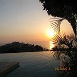 Sunset view across the infinity pool Hotel La Mariposa