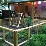 The Waypoint House Vegetable Garden and Back Seating Deck