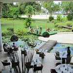 Breakfast area by the water and flower garden feature