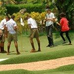 Thai teenagers enjoying their adventure mini golf round