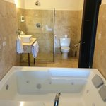 Bathroom with Jacuzzi shower etc