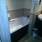 Clean bathroom with an excellent shower