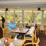 People enjoying a great meal and view in the Oaks Grille.