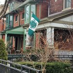 Proud Cabbagetown locals display flags from their residences