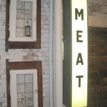 The Big Meat sign on the back wall.
