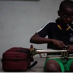 a youngster getting ready for music lessons