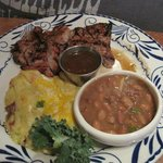 Pork with sweet chile glaze, charro beans, and papas con chile