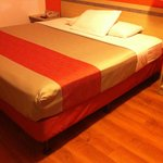 Remodeled Motel 6 bed that looks like remodeled Red Roof bed. Very thin sheets