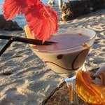 Paradise Sunset cocktail with taro chips during happy hour
