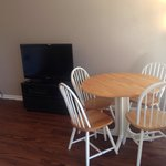 One queen rental, non ocean view room. Image of dining and tv area