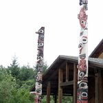 Longhouse with totem poles