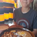 My son with a huge plate of chicken mole!