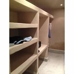 Ample closet and shelving with built in safe