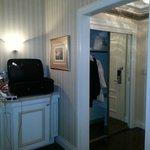 Looking from bedroom towards door.   Minifridge is on left behind door.