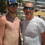 father and son enjoyng the hols