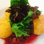goat cheese stuffed fried polenta on cherry and radish ragout.
