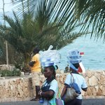 Lovely chambermaids bringing bottled water to rooms