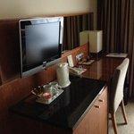 Desk, TV and kettle in bedroom