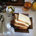 Toast, croissants, pain au chocolat, muffins, apple juice and orange juice