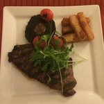 8oz sirloin steak, chunky chips, Portobello mushroom, cherry tomatoes and rocket