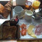 Salmon, cheese, ham, toast, croissants, pain au chocolat, muffins, apple juice and orange juice