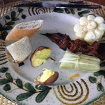 One of several courses.  This featured corn, a tamale and skewered cow's heart (tasted like stea