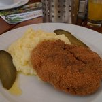Rissole with potato mash and gherkin