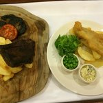 Steak and chips with mushrooms and tomato; and fish and chips with peas and tartar sauce