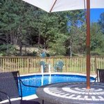 Relax by the outdoor pool and hot tub