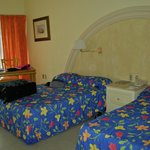 Habitacion con dos camas matrimoniales