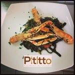 Tagliolini al Nero di Seppia con Scampi,Zucchine e Pomodorino