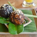 Cassava balls fried and dipped in sugar syrup