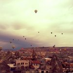 Balloons view from Doors of Cappadocia