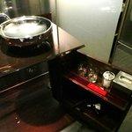Vanity with swivel door open and raised sink
