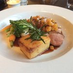 Duck with comfit potato, fresh baby vegetables including a tiny turnip