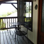 upstairs on the verenda by front door to chalet. cozy table and chairs