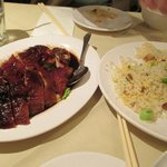 Roasted duck and special fried rice to share with 2 people.