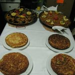 Two kinds of tortilla and paellas made in first day's cooking class