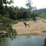 Zip lining across the river
