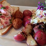 Lobster roll with grilled potato salad and homemade cole slaw.