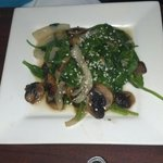 Spinach sauté with mushrooms, onions, capers in sesame seed oil