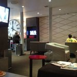 Lobby where Continental breakfast is provided at 7am. AT night it is a bar/lounge