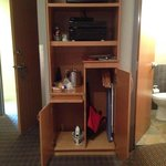 small custom shelve/cabinets for iron, stereo, fridge, pull out shelve, cabinet
