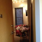 view of room from hallway. jumbo mirror rest against floor/wall across from bed