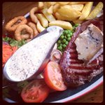 Beautiful Steak with Peppercorn sauce, chips, onion rings, salad.
