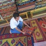 Zapotecan weaver, Bulmaro Perez Mendoza, with his rugs at Teotitlan del Valle.
