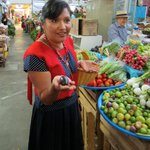 Nora Andrea Valencia displays local ingredients to students of her cooking school, Alma de Mi Ti