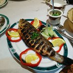 a very nice sea bass with lovely sause and rice