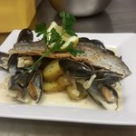 Rainbow trout, fresh mussels in sauce with saute pots