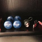 Some small sport equipments and torch on the room closet